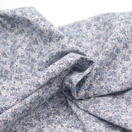Popeline de coton imprimé fleuri bleu