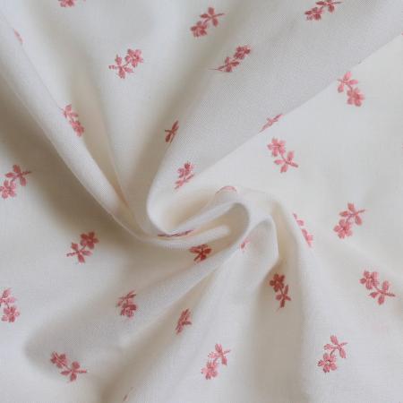 Tissu coton organique broderies fleurs rose