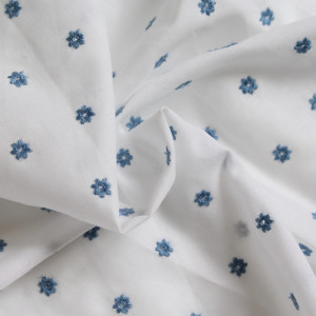 Tissu coton organique broderies fleurs