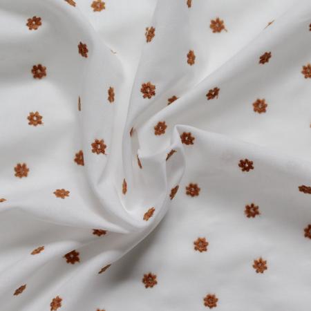 Tissu coton organique broderies fleurs moutarde