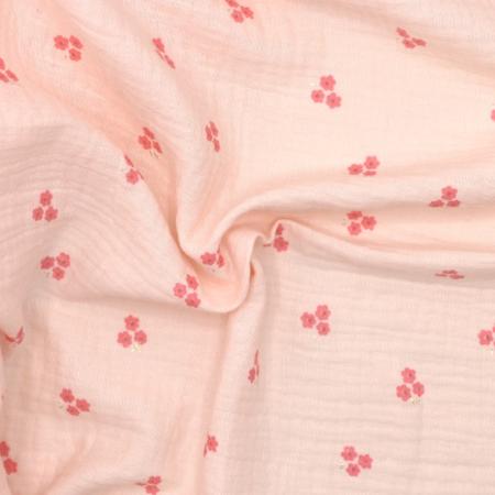 Double gaze de coton rose nude poudré à petites fleurs