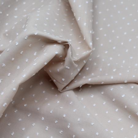 Plumetis de coton bicolore sable et blanc