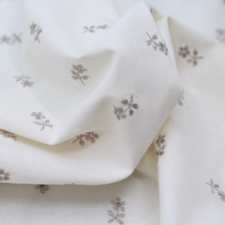 Tissu popeline de coton organique broderie bordé